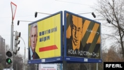 Dueling billboards for parliament speaker Volodymyr Lytvyn (left) and former Foreign Minister Arseniy Yatsenyuk in downtown Kyiv.