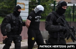 French arrest a high-school friend of Azimov in Strasbourg on May 13.
