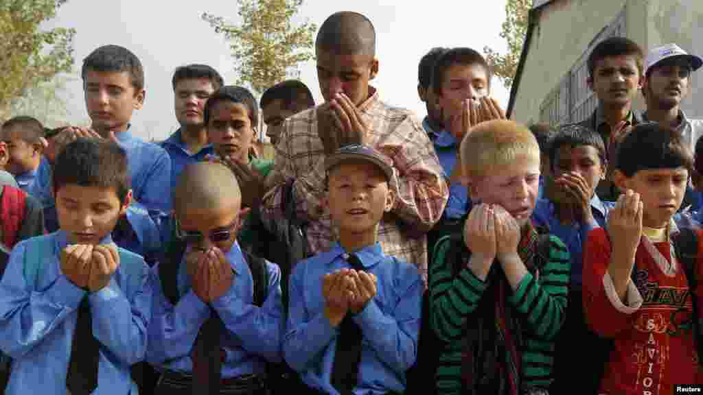 Visually impaired students pray before attending a lesson at the school in Kabul.