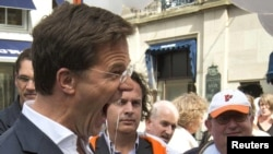 The result appeared to set the stage for the two pro-Europe parties to forge a coalition with Dutch Prime Minister Mark Rutte (pictured campaigning in The Hague) returning for a second term.
