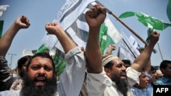 Pakistani activists of the hard-line organisation Jamaat-ud-Dawa (JuD) shout anti-India slogans during a protest against the arrival of Indian Home Minister Rajnath Singh, in Peshawar on August 3.
