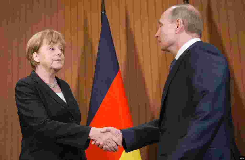 Russian President Vladimir Putin meets with German Chancellor Angela Merkel in Deauville, France on June 6, 2014.