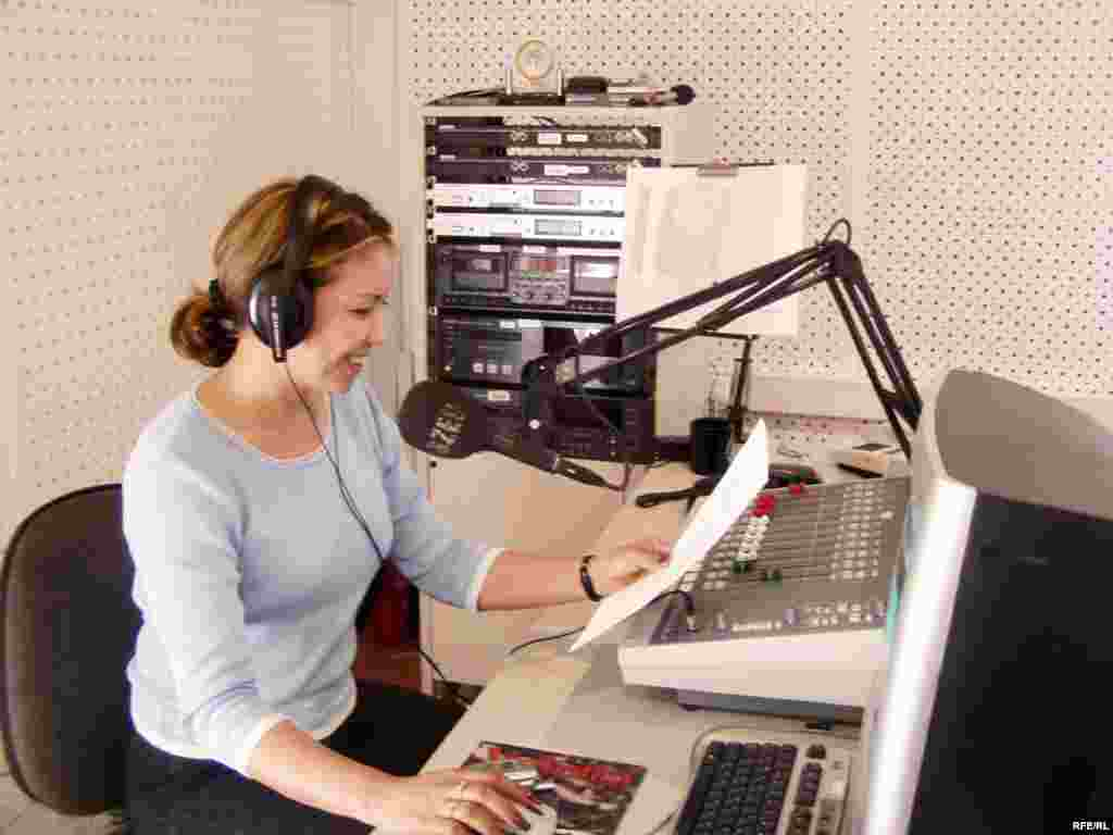 Kyrgyzstan -- female broadcaster on air, RFE/RL Kyrgyz bureau, CPP (Country Page Photo) for new Kyrgyz Service website - Kyrgyzstan -- female broadcaster on air at RFE/RL Kyrgyz bureau; CPP (Country Page Photo) for new website for Kyrgyz Service