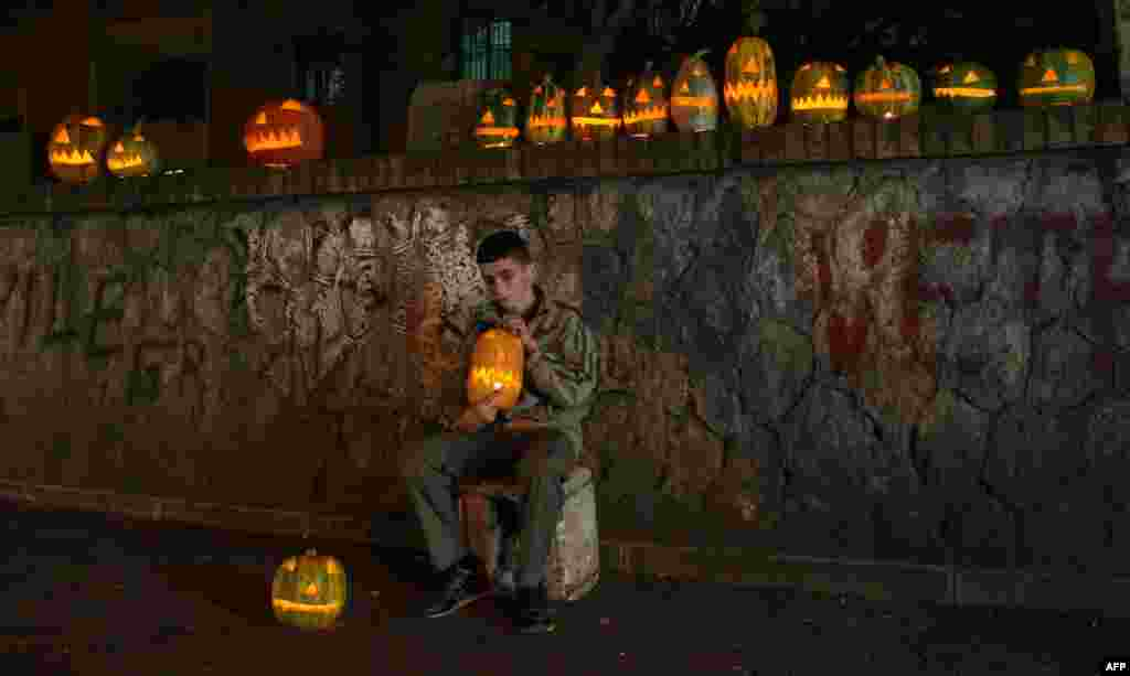 A boy sells carved Halloween pumpkins in Tirana, Albania. (AFP/Gent Shkullaku)