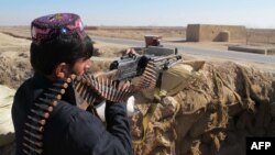 Owganystanyň ýerli polisiýa wekili, Helmand welaýatynyň Marjah etraby, 23-nji dekabr, 2015.