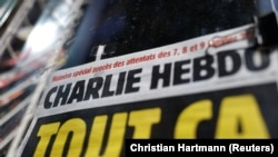 The front page of French satirical magazine Charlie Hebdo is seen at a newspapers kiosk in Paris on the opening day of the trial of the January 2015 Paris attacks against Charlie Hebdo satirical weekly