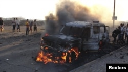 A truck that belonged to Shi'ite Muslim rebels burns during clashes in Aden on March 26.
