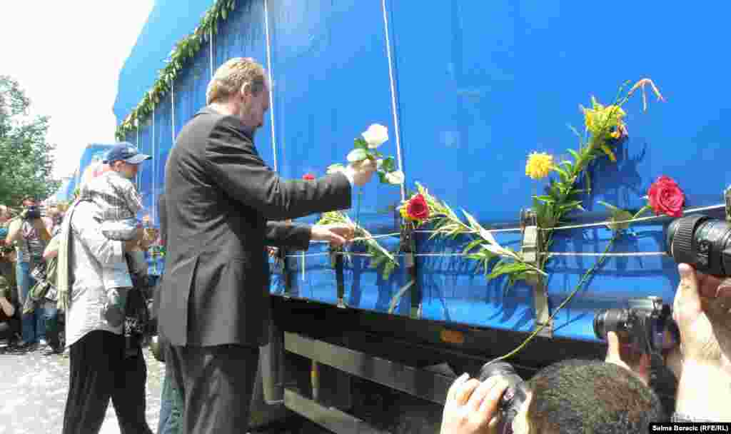 More flowers being placed on the trucks.