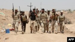 متطوعون من قوات الحشد الشعبي في شمال بغداد