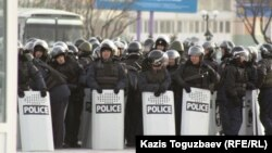 Riot police stand on duty in the western city of Aqtau, where the Kazakh authorities have maintained a heavy presence on the streets.