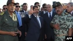 الرئيس مرسي خلال زيارته الاخيرة الى العريش