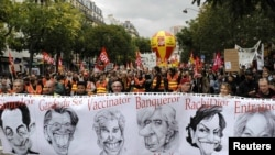 Private- and public-sector workers attend a demonstration over pension reforms in Paris on October 19.