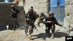 Afghan soldiers take up positions during a patrol in the Batikot district in September 17.