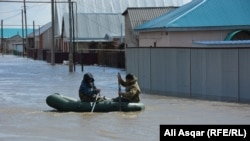 According to Kazakh authorities, almost 2,000 buildings were destroyed floods in the north of the country.