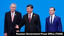 Russian Prime Minister Dmitry Medvedev (right), with Chinese President Xi Jinping (center) and Czech President Milos Zeman on November 5 in Shanghai.