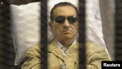 Ousted Egyptian President Hosni Mubarak sits inside the caged dock of a courtroom in Cairo on June 2, when he was sentenced to life in prison over the deaths of protesters.