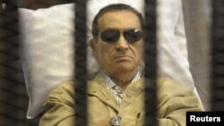 Former President Hosni Mubarak sits inside a cage in a courtroom in Cairo during sentencing on June 2.