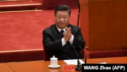 Қытайдағы реформалар мен ашықтық саясатының 40 жылдығын атап өту шарасында отырған Қытай басшысы Си Цзиньпин. 18 желтоқсан 2018 жыл
