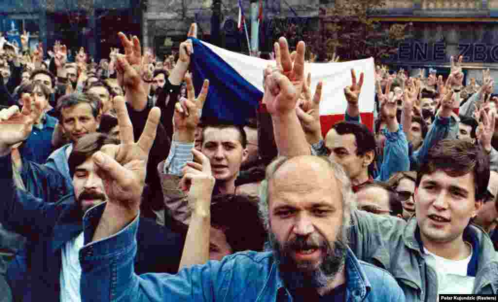 The next protest was held on October 28, 1989, the anniversary of the founding of Czechoslovakia in 1918. Demonstrators flashed victory signs as they demanded freedom and democracy on Wenceslas Square in Prague.