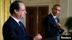 Barack Obama (djathtas) dhe Francois Hollande gjatë një takimi në Uashington në shkurt të këtij viti