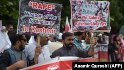 Pakistani Kashmiris hold placards during an anti-Indian protest at the diplomatic enclave in Islamabad on August 5.