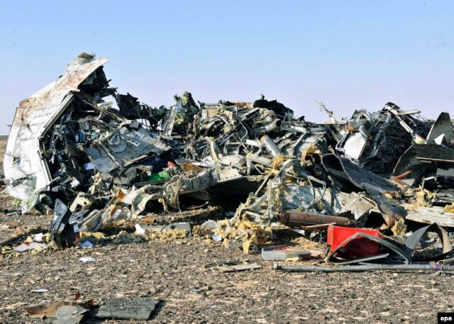 Debris from the crashed Russian jet lies strewn across the sand at the site of the crash in Egypt's Sinai.