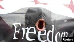 Një protestues sirian