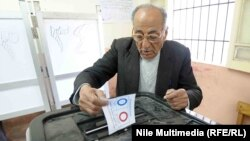 An Egyptian man takes part in the two days of referendum voting on the new constitutional draft in Cairo on January 14.