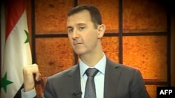 President Bashar al-Assad gives an interview to Turkish media in Damascus on April 3.