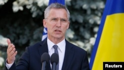 NATO Secretary-General Jens Stoltenberg speaks during a press conference with Ukrainian President Petro Poroshenko following a meeting of the NATO-Ukraine Commission in Kyiv on July 10.
