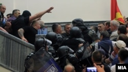 More than 200 protesters, some wearing masks, stormed the building after the new majority in the legislature had elected an ethnic Albanian as speaker, paving the way for the formation of a government led by the Social Democrats.