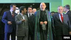 Iranian President Mahmud Ahmadinejad (2nd left) with his counterparts from Tajikistan Emomali Rahmon (left), Afghanistan Hamid Karzai (2nd right) and Iraq Jalal Talabani, at the ECO summit.