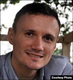 Аналитик Андрей Елисеев