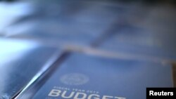 Copies of U.S. President Barack Obama's 2012 budget are unveiled on Capitol Hill in Washington.