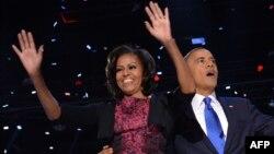 Американскиот претседател Барак Обама со сопругата Мишел ја прославува изборната победа.