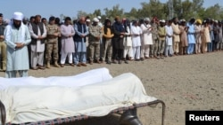 Abdul Malik, chief minister of Balochistan (sixth from left, along with Pakistan Army soldiers and locals, attends a funeral prayer for the victims of a gunmen attack on a construction site, in Turbat, Balochistan, on April 11.