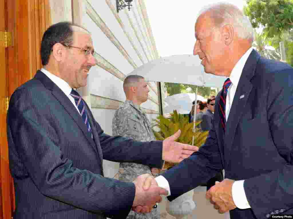 Iraq -- Prime Minister Nuri al-Maliki greets US Vice Predident Joseph Biden during his visit to Baghdad, 31Aug2010 - Iraqi PM Nuri al-Maliki receives US Vice Predident Joseph Biden during his visit to Baghdad.
