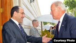 Iraqi Prime Minister Nuri al-Maliki (left) welcomes U.S. Vice President Joe Biden to Baghdad on August 31.