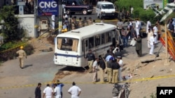 Navy investigators have been looking into the bus bombing in Karachi which reportedly killed five people.
