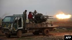ИМ содырларымен соғысып жатқан Сирияның режимін қолдаушы қарулы топ. Алеппо, 14 қаңтар 2016 жыл. Көрнекі сурет