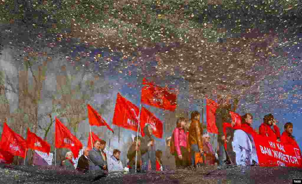 Communist Party supporters attend a May Day rally in the Ivanovo region of Russia. (ITAR-TASS/Vladimir Smirnov)