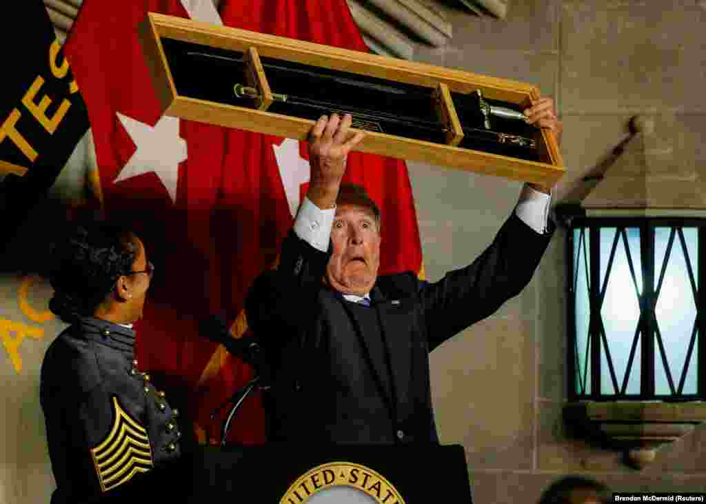 Former U.S. President George W. Bush is presented with a cadets' sword as he is honored with the Sylvanus Thayer Award at the U.S. Military Academy at West Point, New York. (Reuters/Brendan McDermid)