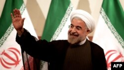 Iran -- President-elect Hassan Rohani waves as he attends a press conference in Tehran, 17Jun2013