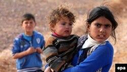 Дети в лагере для сирийских беженцев в Иордании. 30 января 2016 года.