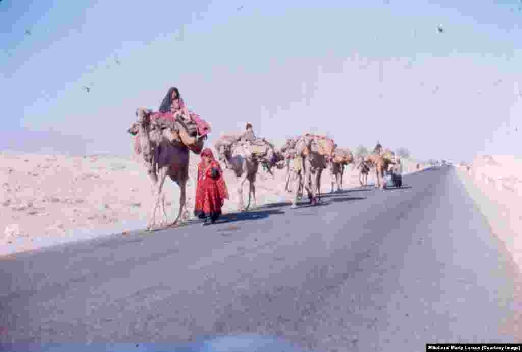 Kuchis (nomads) on the road from Jalalabad to Kabul. Elliot says such a sight was common during his time there in the 1970s, but is increasingly rare today.