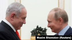 Russian President Vladimir Putin (right) meets with Israeli Prime Minister Benjamin Netanyahu in Moscow on January 30.