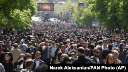 ARMENIA -- Opposition demonstrators throng in a tree lined avenue during a rally to protest the former president's shift into the prime minister's seat in Yerevan, April 17, 2018