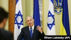 UKRAINE –Israeli Prime Minister Benjamin Netanyahu gestures while speaking during his and Ukrainian President Volodymyr Zelenskiy, joint news conference following their talks in Kyiv, August 19, 2019