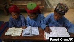 Pakistani children read the Koran at a madrasah in Karachi in November.