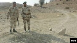 Pakistani paramilitary soldiers guard the site of a landmine blast planted by alleged Baluch nationalists in the Dera Bugti region in 2006.